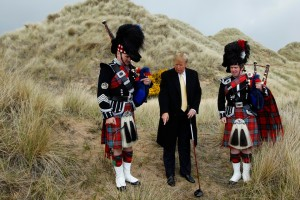 U.S. property mogul Trump poses next to bagpipers during a media event on the sand dunes of the Menie estate in Scotland