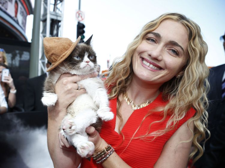 Grumpy Cat arrives with his owner Tabatha Bundesen at the 2014 MTV Movie Awards in Los Angeles