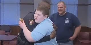 ryan-paul-hugs-officer