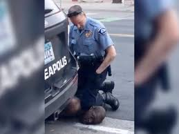 Officer Derek Chauvin with hands in pockets kneeling on George Floyd's neck
