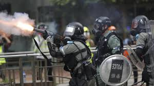 Police shooting tear gas against protestors